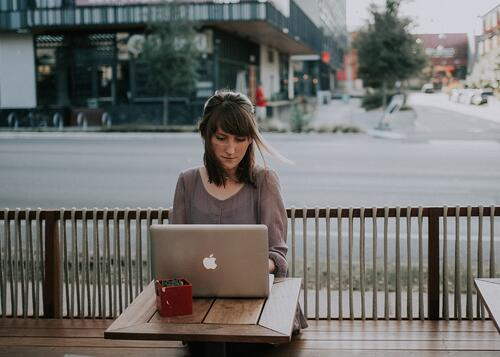woman-booking-room-on-laptop