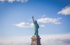 https://www.otainsight.com/hubfs/2021/Blogs-News-Customer-Stories/Travel-resumes-in-the-United-States/Statue-of-liberty-blue-sky.jpg